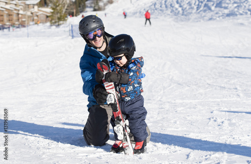 Foto auf AluDibond Wintersport Toddler Learning to Ski at a Colorado Resort Dressed Safely with Helmet, Sunglasses & Harness