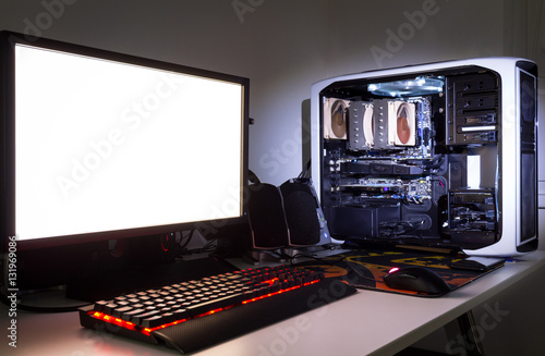 Fotografering Custom built gaming computer with white screen, keyboard, mouse, desktop, components, hardware, gaming chair under low light