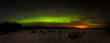 Green arc of northern lights i winter