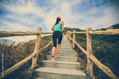 Papiers peints young fitness woman running on mountain stairs
