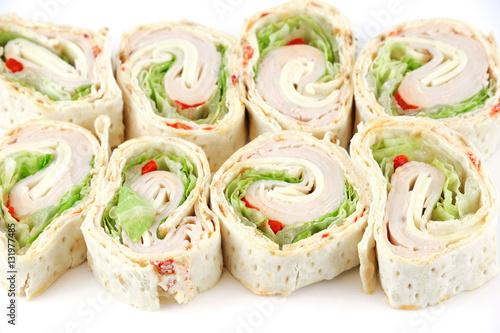 Fotografie, Obraz  tortilla deli wrap rolls with ham vegetable isolated on white background