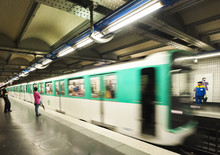 Paris Metro Train Approaching A Station At Speed.
