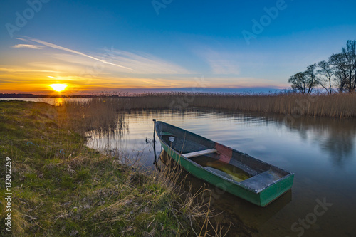 Fotobehang Pier fishing boats on the lake during sunset, lake Miedwie, Poland