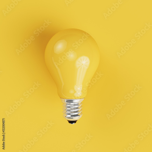 Photo  Yellow Light bulb on yellow background.
