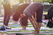 Asian woman doing yoga or exercise in the park