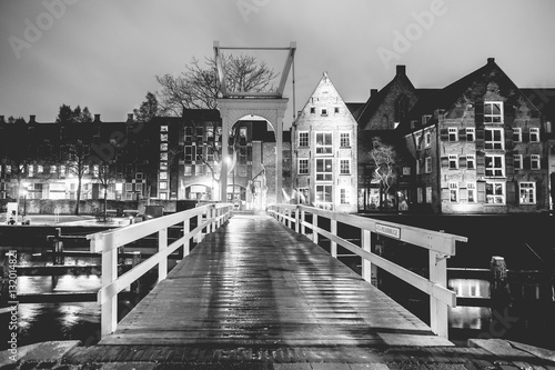 Old white bridge  over a canal in the Netherlands