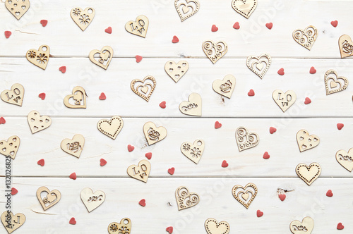 Fototapety, obrazy: Texture of different shape heart figures on white wooden background