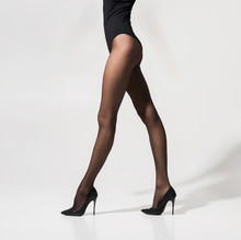 Sexy Legs Of A Young Woman In Erotic Stockings