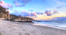 Sunset Over The Coastline Of One Thousand Steps Beach With Tidal Pools And Cliffs In Laguna Beach, California, USA