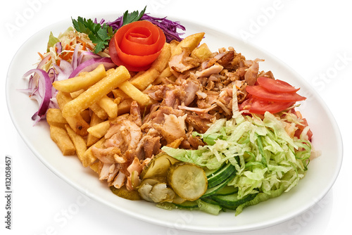Foto  Doner kebab on a plate with french fries and salad