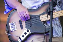 Close Up On Bass Guitar And Mu...