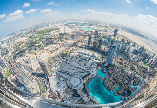 Fotografie, Obraz  Downtown Dubai and artificial lakes - Aerial view with fisheye l