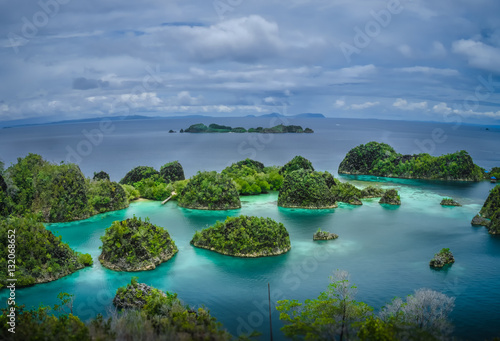 Tuinposter Indonesië Painemo Islands, Blue Lagoon with Green Rockes, Raja Ampat, West Papua, Indonesia