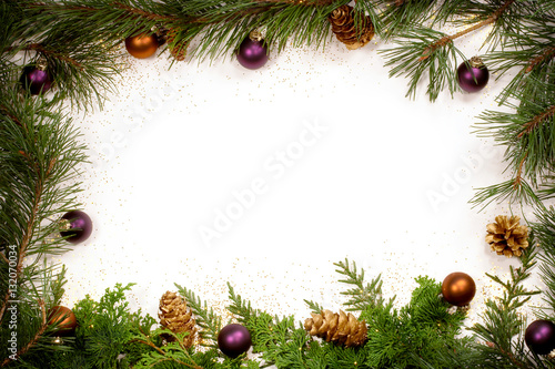 frame of christmas greenery pine cones glitter and decorations in purple and gold - Christmas Greenery
