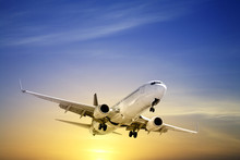 Jet Aeroplane Landing At Sunset Blue Yellow Copy Space