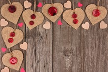Corner Border Of Valentines Day Burlap Hearts With Buttons And Confetti Over A Rustic Wooden Background