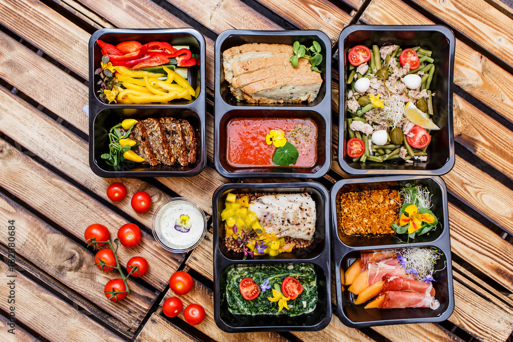Fototapety, obrazy: Healthy food and diet concept, restaurant dish delivery. Take away of fitness meal. Weight loss nutrition in foil boxes. Steamed veal with cous and vegetables at wood