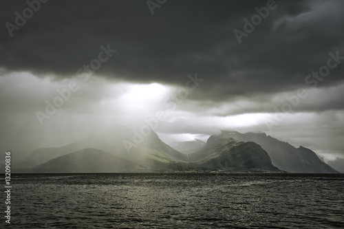 Norwegian landscape. The ray of light makes its way from behind the clouds. The county of More og Romsdal. Norway.