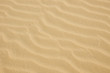 closeup of yellow sand pattern on a beach in the summer