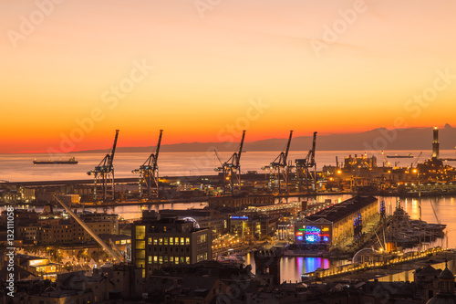 Foto op Plexiglas Venetie GENOA (GENOVA) , ITALY, DECEMBER 28, 2016: Sunset view of the city of Genoa, Italy, The harbor with Lanterna (lighthouse) the symbol of the city.