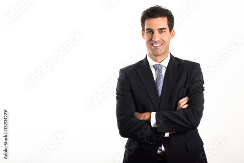 Photo  Businessman wearing blue suit and tie on white background.