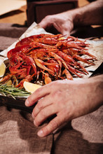 Close Up Of Mans Hands Holding A Tray With Crayfishes