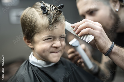 Small kid in barbershop Canvas Print