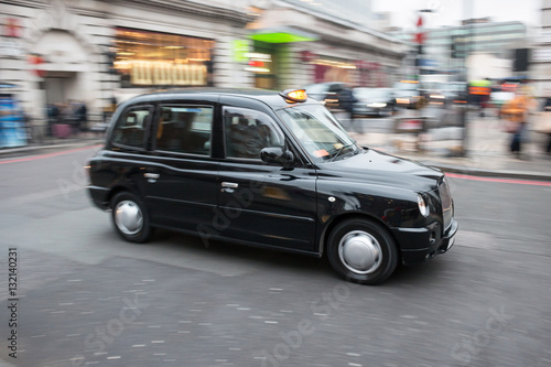 Fényképezés London black cab taxi in motion on the street