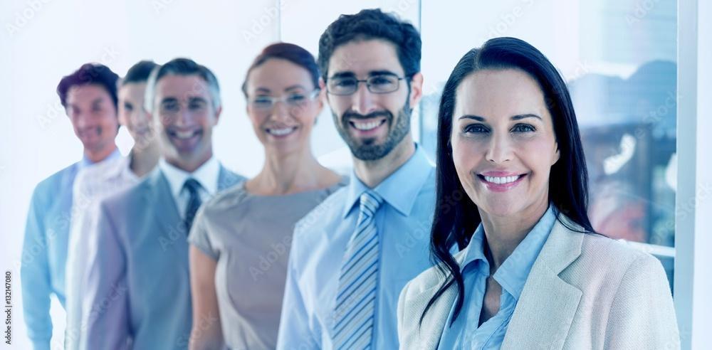 Fototapeta Smiling employees in a line