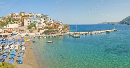 Foto auf Gartenposter Stadt am Wasser beach and small port on sunny day panorama