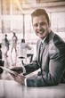 Smiling businessman using digital tablet office