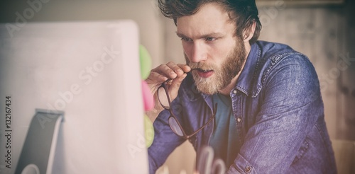Focused hipster working at his desk Slika na platnu