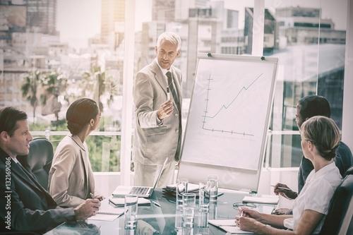 Fototapeta Serious businessman giving a presentation obraz