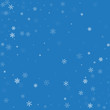 Sparse snowfall. Abstract scattered pattern on blue background. Vector illustration.