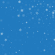 Sparse snowfall. Random scatter on blue background. Vector illustration.
