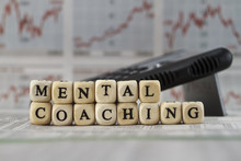 Mental Coaching Built With Letter Cube On Newspaper Background