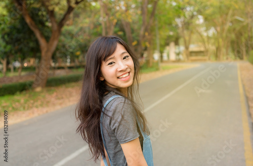 Fototapety, obrazy: Portrait of cute young woman smiling relaxing in park enjoying her freedom wear short dress