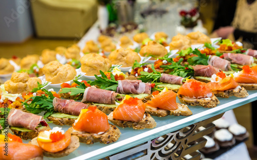 Poster Appetizer Delicacies and snacks at a buffet or Banquet. Catering