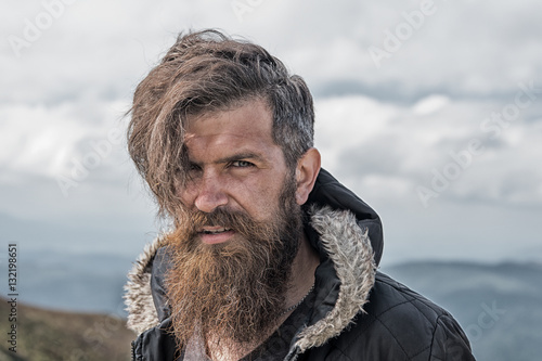 Fotografie, Obraz  man hipster traveler with beard and moustache portrait on mountain