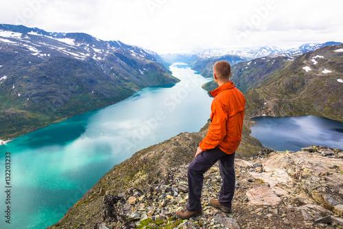 Photo  Happy people relax in cliff during trip Norway. Bessegen area