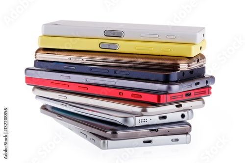 Fotografie, Obraz  Pile of mobile phone. Heap of the different smartphones isolated