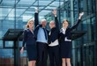 Cheerful businesspeople standing outside office