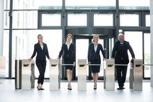 Businesspeople Standing At Tur...