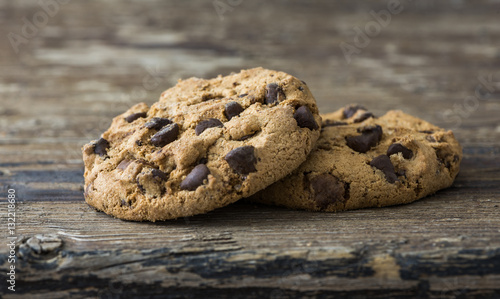 Fotobehang Koekjes Pair of Chocolate Chip Cookies on Rustic Wooden Background