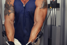 Handsome Athlete Working With Special Equipment At The Gym.Antal