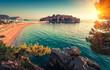 Leinwandbild Motiv View in the Adriatic sea and Sveti Stefan at sunset. Milocer Park. Coast Budva Riviera. Montenegro.