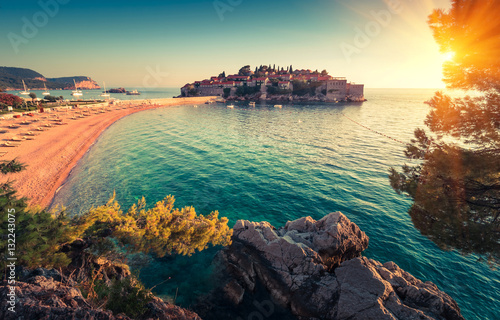 Cote View in the Adriatic sea and Sveti Stefan at sunset. Milocer Park. Coast Budva Riviera. Montenegro.