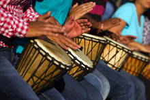 Group Of People Playing With African Drums