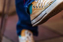 Color Picture Of Woman Feet Wearing Yellow Sneakers, Detail