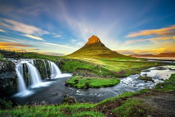 Sunset over Kirkjufellsfoss Waterfall and Kirkjufell mountain in Iceland